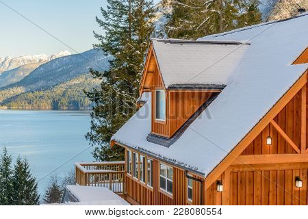 A typical american house in winter. Snow covered. Fantastic ocean view.