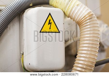 electricity, power and energy concept - electric panel with caution sign