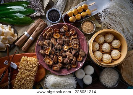 Shiitake rice dumplings steamed pork buns noodles Asian cuisine food mix