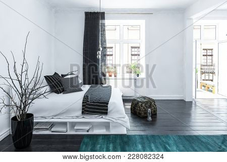 Large spacious grey and white bedroom interior in a luxury home with a stylish storage bed, accent black pouffe,cushions and drapes on a wooden floor with bright light windows, 3d rendering