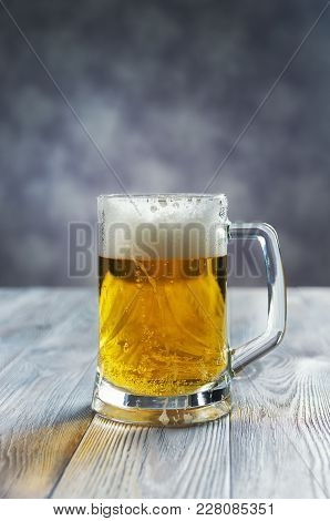 Glass Of Cold Beer On A Blue Background.