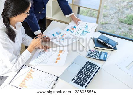 Teamwork Of Business Colleagues Consultation Market Growth On Financial Document Graph Report, Profe