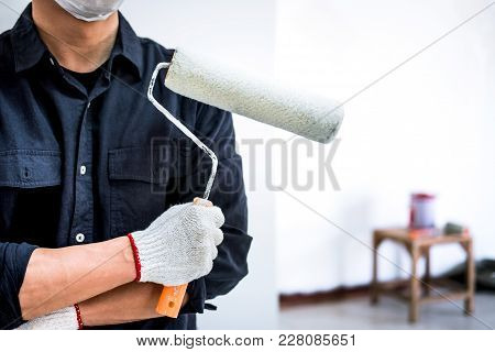 Male Painter With Arm Crossed Holding Paint Roller, Interior Working With Paint Roller In Room, Shap