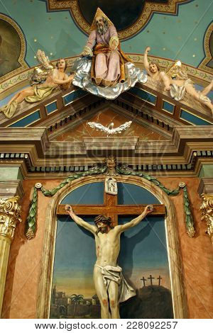 ZACRETJE, CROATIA - AUGUST 06: Crucifixion, altarpiece in the Parish Church Exaltation of the Holy Cross in Zacretje, Croatia on August 06, 2017.