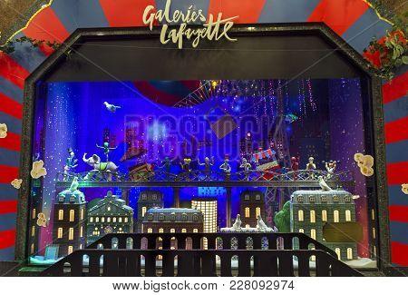 Paris, France - December 12, 2017: Christmas Decorations In The Shop Window Of A Parisian Galeries L