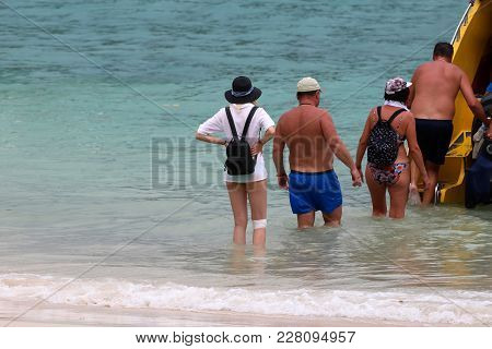 Injured Tourist Girl Are Waiting To Go Back On Speed Boat On The Beach In Thailand.