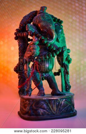 Hindu God - Lord Ganesha With Rudraksha Rosary In A Colorful Light. Colorful Photo Of Deity Ganesha