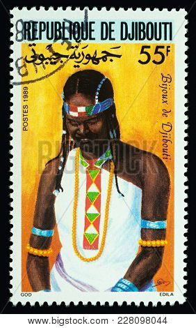 Moscow, Russia - February 23, 2018: A Stamp Printed In Djibouti Shows African Girl In Dress With Tra