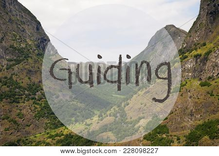 English Text Guiding. Valley With Mountains In Norway. Peaceful Landscape, Scenery With Grass, Trees