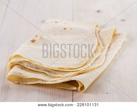 Armenian Flat Bread Lavash. Pita Bread On White Wooden Table. Copy Space.