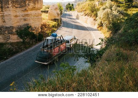 Turkey, Cappadocia, Goreme, June 12, 2017: Parts Of Hot Air Balloon Is Carried In Trailer On The Roa