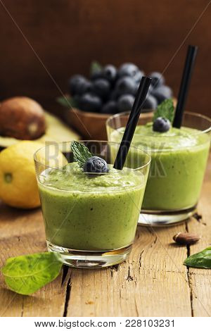 Smoothie Recipe With Green Spinach, Almond On  Wooden Board. Well Being And Weight Loss Concept.