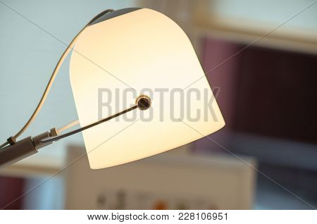 An Ivory Modern Lamp In The Interior, With Blurred Background