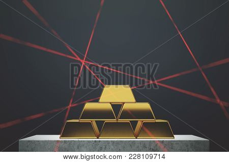 Gold Bars Pyramid Standing Against A Black Wall On A Marble Table. Laser Rays. Concept Of Savings An