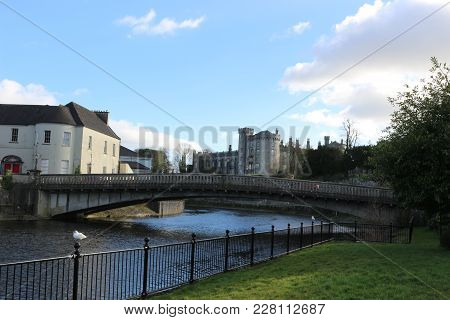 Beautiful Flower Lined Riverside Railings View Of Kilkenny Castle Town And Bridge