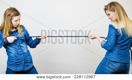 Two Women Having Argue Pulling Rope Being Mad At Each Other. Bad Rivalry Relationship.