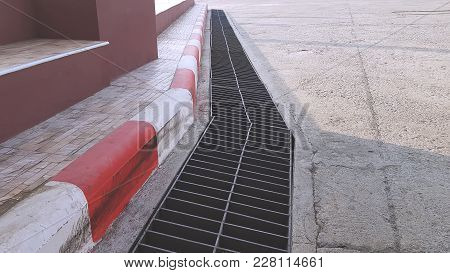 Diminishing Perspective Of Red And White Footpath, Parking Not Allowed