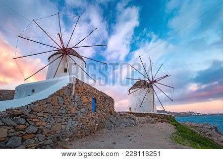 Famous View, Traditional Windmills On The Island Mykonos, The Island Of The Winds, At Sunrise, Greec