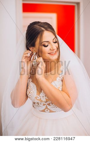 Wedding Earrings On A Female Hand, She Takes The Earrings, The Bride Fees, Morning Bride, White Dres