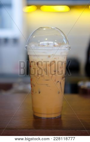 Ice Coffee On A Wooden Table In Coffee Shop