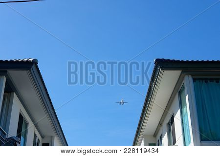 Airplane Flying In The Sky Over My Home