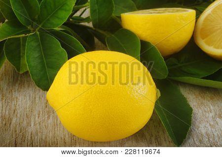 Fresh Lemon Fruit At On Wooden Background