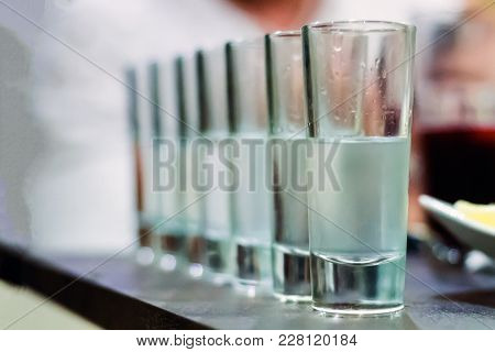 Transparent Alcohol Shots Glasses In A Row