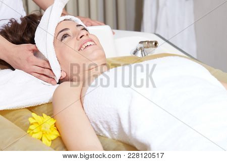 Female Enjoying Relaxing On Massage Water Bed In Cosmetology Spa Center