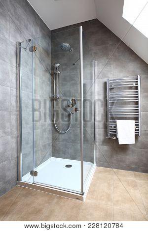 New Modern Clean Bathroom. Transparent Shower Cabin. Modern Interior Of New Bathroom.