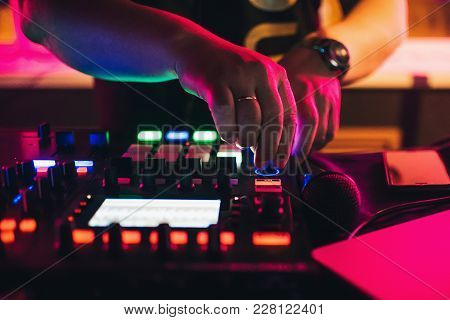 Hands Of A Dj Playing At A Professional Mixer In Nightclub Closeup