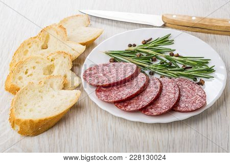 Pieces Of Smoked Sausage, Rosemary, Black Pepper And Carnation In Plate, Pieces Of Bread, Kitchen Kn