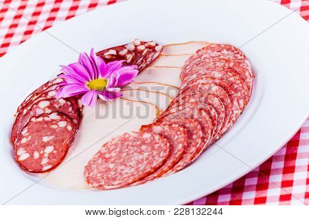 Smoked Sausage And Salted Salo On White Plate
