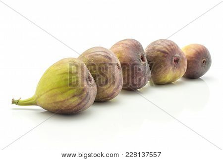 Five Figs Isolated On White Background Fresh Ripe Purple Green In Row