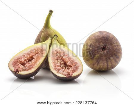Two Figs And Two Sliced Halves Rose Flesh Isolated On White Background Ripe Fresh Purple Green