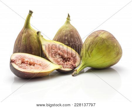 Three Figs And Two Sliced Halves Rose Flesh Isolated On White Background Ripe Fresh Purple Green