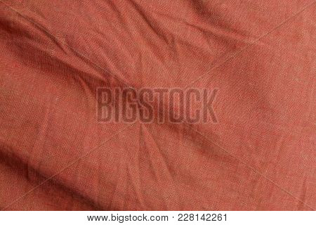 Red Background Of A Piece Of Crumpled Cloth