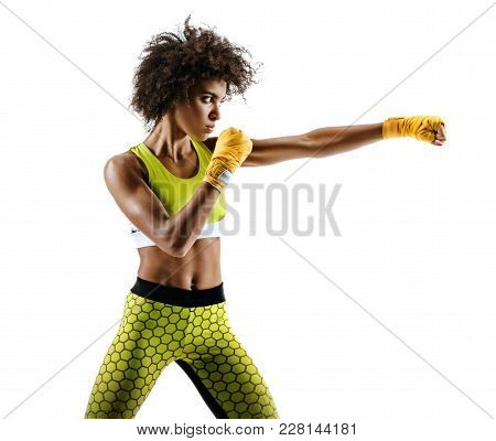 Boxer Woman Making Direct Hit. Photo Of Sporty African Woman During Boxing On White Background. Dyna