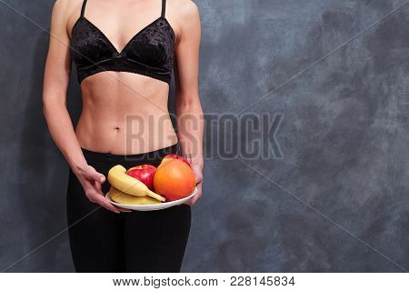 Fit Woman With A Plate Of Fruits, Copy Space. Diet, Healthcare, Weight Loosing, Fitness, Well-being