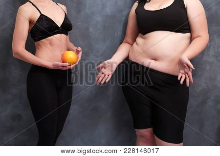 Fit Woman With Grapefruit And Starving Overweight Lady. Anorexia, Hunger Harm, Healthcare, Weight Lo