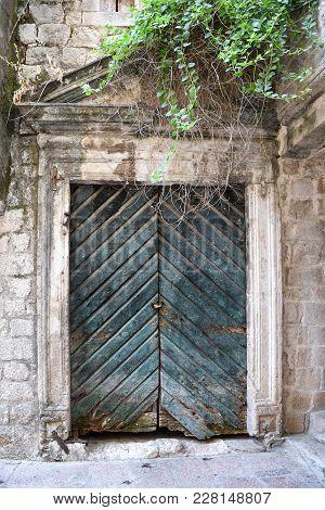 Old Wooden Green Doors In Montenegro In Kotor