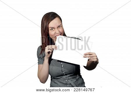 Young Woman On A White Background Holds A Clean White Banner Of The A4 Format, Biting One Of Its Cor