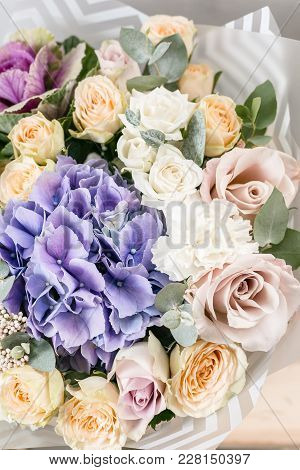 Beautiful Bouquet Of Mixed Flowers Into A Vase On Wooden Table. Bouquet From Cultivated Flowers In A