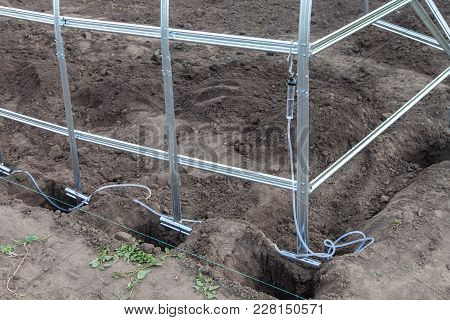 Installation Of Frame Greenhouse Outdoors, Leveling With Water Level Gauge