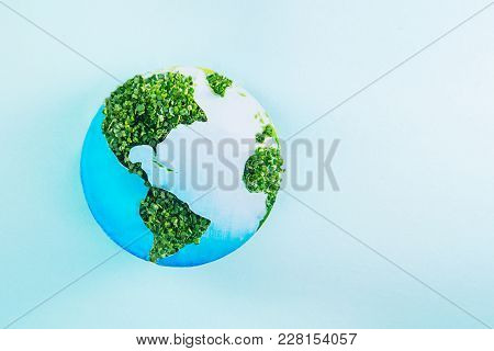 Earth Model Made Of Paper And Fresh Green Sprouts Collage On Blue Background. Green Planet Creative