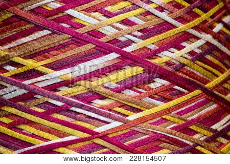 Colored Thread On A Bobbin Texture Background