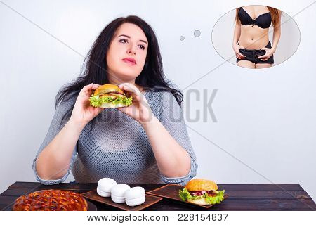 Overweight Obese Woman Eating Hamburger And Dreaming Of Fit And Slim Body. Weight Losing, Obesity, H