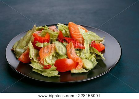Delicious Fresh Vegetable Salad With Salmon On Black Plate, Healthy Food Close Up