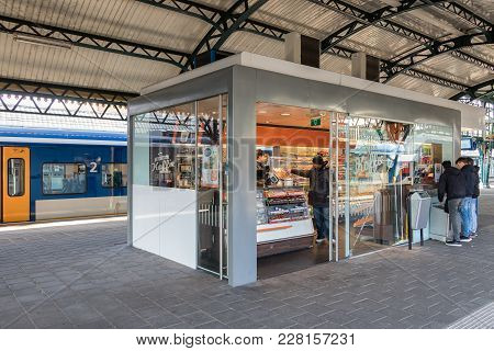 Den Bosch, The Netherlands - February 01, 2018: Customers Buying Drinks And Sweets At Kiosk In Den B
