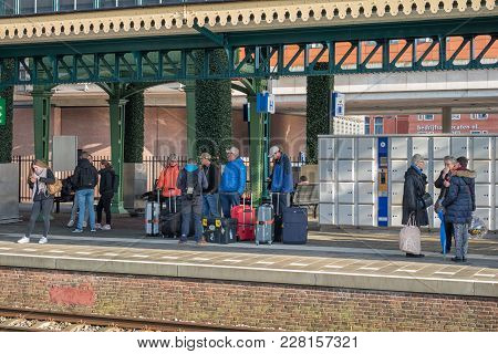 Den Bosch, The Netherlands - February 01, 2018: Travellers With Luggage Waiting For The Train At Den