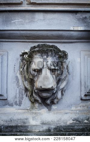Front View Closeup Of Lion Head Sculpture Carved In Stone On The Exterior Of A Historical Building